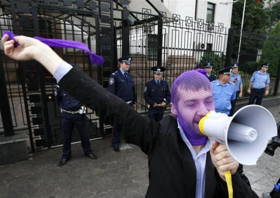 "A supporter of the female punk band ""Pussy Riot"" shouts slogans during a gathering outside the Russian embassy in Kiev, August 17, 2012."