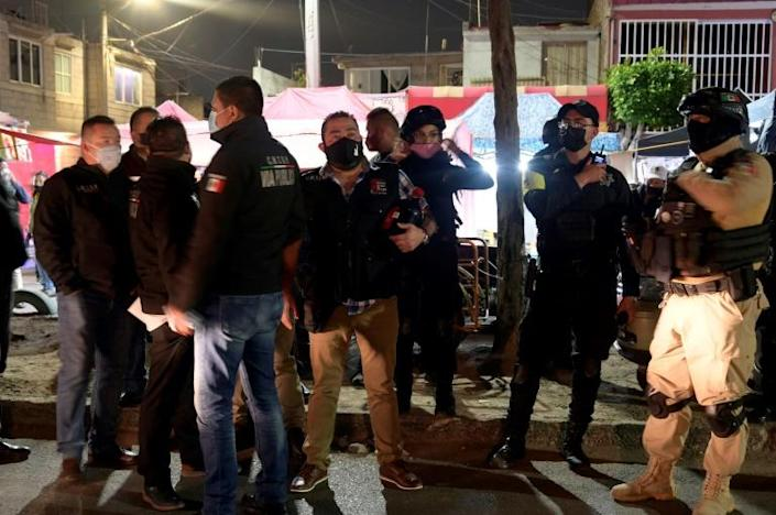 Police enforcing Covid-19 restrictions raid an underground party outside Mexico City on December 18, 2020