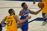 New York Knicks guard RJ Barrett (9) lays the ball up as Utah Jazz center Rudy Gobert (27) defends in the first half during an NBA basketball game Tuesday, Jan. 26, 2021, in Salt Lake City. (AP Photo/Rick Bowmer)