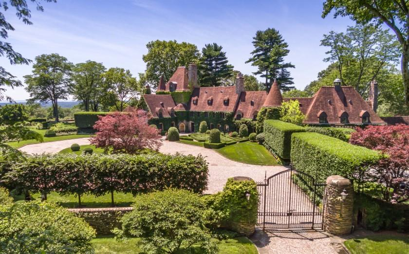 The park-like grounds center on a 13,000-square-foot mansion surrounded by rolling lawns, manicured hedges, water features and a tennis court.
