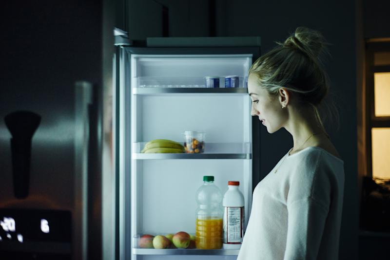 Snacking late at night could have a negative impact on losing weight (Getty)