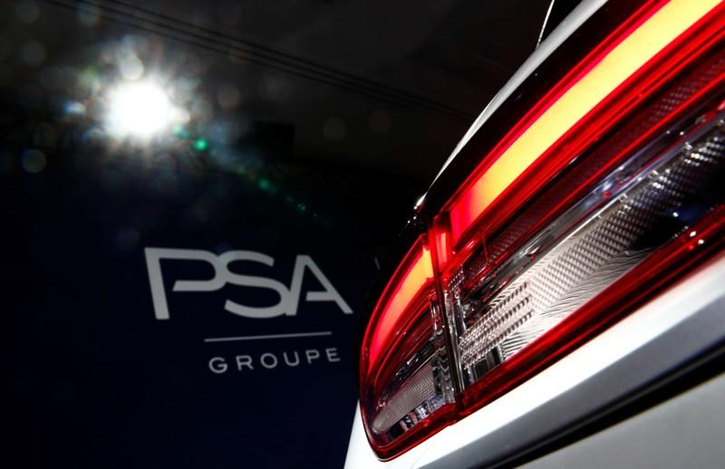 A PSA Group logo is seen behind a car displayed during French carmaker's news conference as they announce the company's 2018 results at their headquarters in Rueil-Malmaison