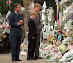 <p>The Prince of Wales, Prince William, and Prince Harry look at floral tributes dedicated to the late Diana left outside Kensington Palace on September 5, 1997, just days after her tragic death. </p>