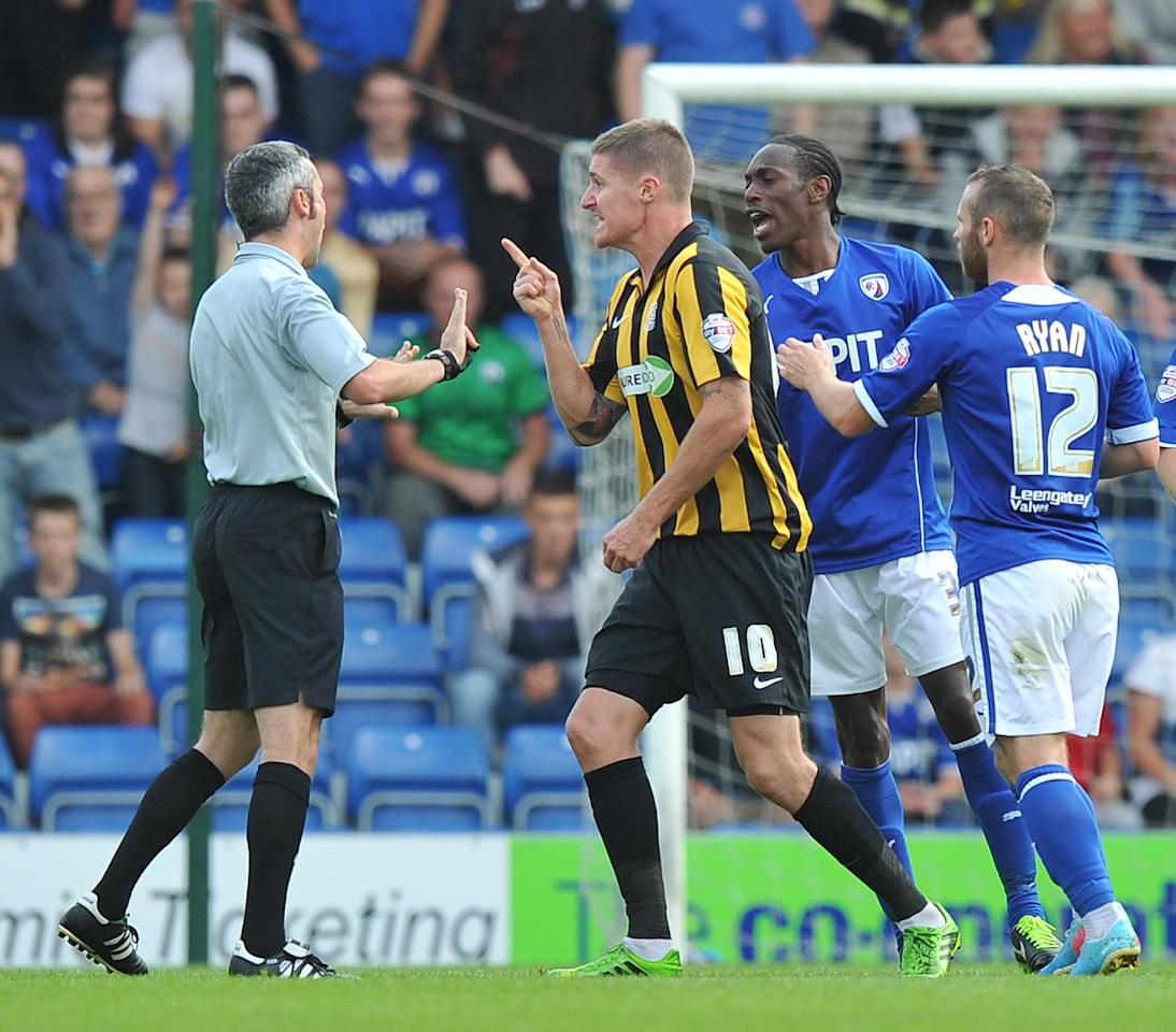 Southend United's Barry Corr argues with the referee during the Sky Bet Football League Two match at the Proact Stadium, Chesterfield.