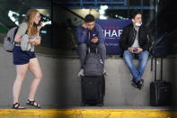 Travelers wait for public transportation at O'Hare International Airport in Chicago, Friday, July 2, 2021. AAA forecasts that more than 47 million people will travel by car or plane this weekend in the U.S., a return to 2019 levels and 40% higher than last year. (AP Photo/Nam Y. Huh)