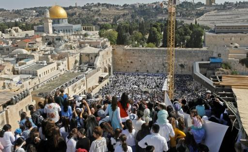 The Western Wall is located on the Temple Mount, the most sacred place in Judaism, and is directly adjacent to the Al-Aqsa mosque, one of the holiest sites in Islam