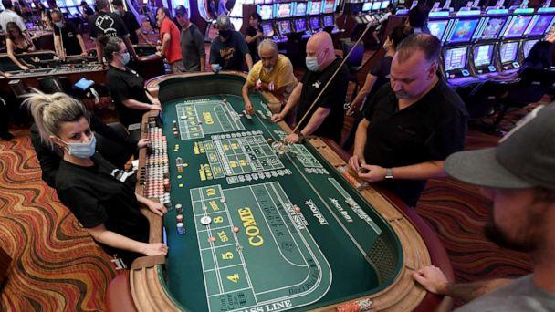 PHOTO: Guests play craps at the Red Rock Resort after the property opened for the first time since being closed on March 17 because of the coronavirus (COVID-19) pandemic on June 4, 2020 in Las Vegas. (Ethan Miller/Getty Images)