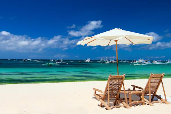 Beach chairs on perfect tropical white sand beach in Boracay, Philippines
