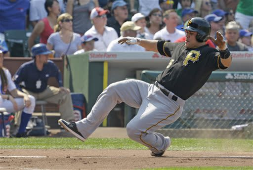Pittsburgh Pirates' Russell Martin scores on a single hit by Francisco Liriano during the second inning of a baseball game against the Chicago Cubs in Chicago, Friday, July 5, 2013. (AP Photo/Nam Y. Huh)
