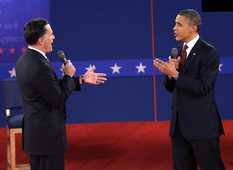 Republican presidential nominee Mitt Romney and President Barack Obama speak during the second presidential debate at Hofstra University, Tuesday, Oct. 16, 2012, in Hempstead, N.Y. (AP Photo/Eric Gay)