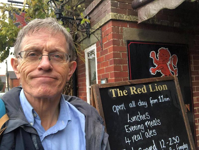 Simon outside the Red Lion pub, the second 'checkpoint' in the hitch race (Simon Calder)
