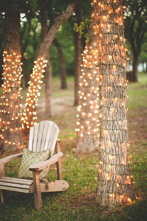 """<p>Create a romantic spot by twisting a string of white lights around a cluster of trees in your backyard. Not only will this create an enchanting place to sit in the evenings, but it will be charming to look at from inside your home.</p><p><strong>See more at <a href=""""http://www.stevenmichaelphoto.com/2011/06/23/ruben-elise-wedding-photographer-decatur-tx/"""" rel=""""nofollow noopener"""" target=""""_blank"""" data-ylk=""""slk:Steven Michael Photography"""" class=""""link rapid-noclick-resp"""">Steven Michael Photography</a>.</strong></p><p><strong><strong><a class=""""link rapid-noclick-resp"""" href=""""https://www.amazon.com/Prextex-100-Count-Clear-Christmas-Decorations/dp/B075LQ4WTF/ref=sxin_6_osp104-8d4d435c_cov?tag=syn-yahoo-20&ascsubtag=%5Bartid%7C10050.g.3404%5Bsrc%7Cyahoo-us"""" rel=""""nofollow noopener"""" target=""""_blank"""" data-ylk=""""slk:Shop Christmas lights"""">Shop Christmas lights</a></strong><br></strong></p>"""