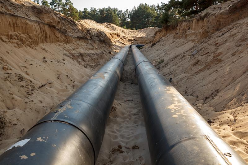 An uncovered pipeline construction site with sand around it