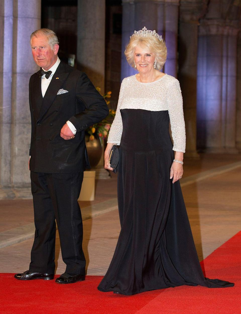 <p>Camilla wowed in a black and white dress with sequined detailing on the top, which she wore to a dinner hosted by Queen Beatrix of the Netherlands in Amsterdam. The Duchess also wore a stunning tiara to finish off her ensemble. </p>
