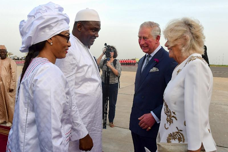 Prince Charles and Camilla were welcomed by Gambia's President Adama Barrow and his wife Fatou Bah Barrow at the airport in Banjul