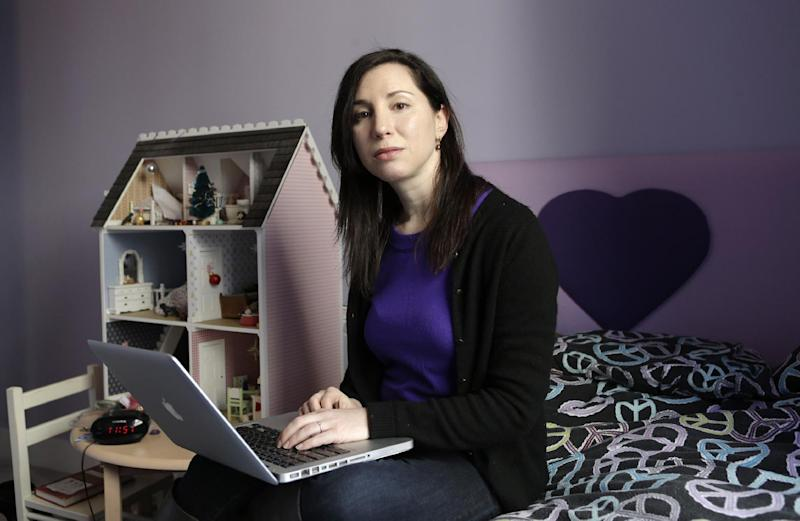 In this March 4, 2013 photo, Rebecca Levey, mother of 10-year-old twin girls, poses for a photograph in the girls' bedroom in New York. Levey, who also runs a tween video review site called KidzVuz.com and blogs about technology and educations issues, says, ìWhat sex education used to be_ it's now the 'technology talk' we have to have with our kids.î She explains that children need to understand the pitfalls of carelessly sharing personal information online. (AP Photo/Kathy Willens)