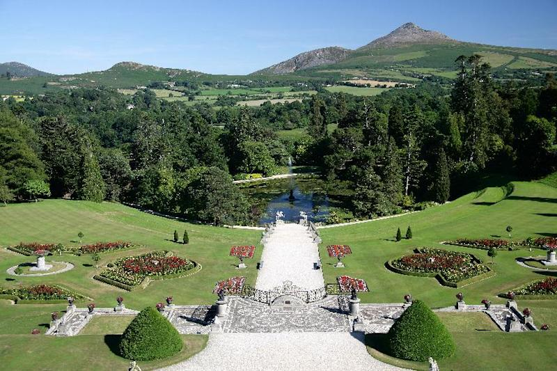 "This undated photo from the Powerscourt Estate shows the gardens and grounds of the estate in Enniskerry, County Wicklow, Ireland, with the Wicklow Mountains in the background. The Powerscourt Estate and other great houses, castles and gardens in Ireland are hosting events connected to The Gathering, a yearlong nationwide event inviting Irish emigrants and their descendants home to celebrate their heritage. Powerscourt recently hosted a talk by a genealogist to help visitors track their ""Wicklow roots."" (AP Photo/Powerscourt Estate)"