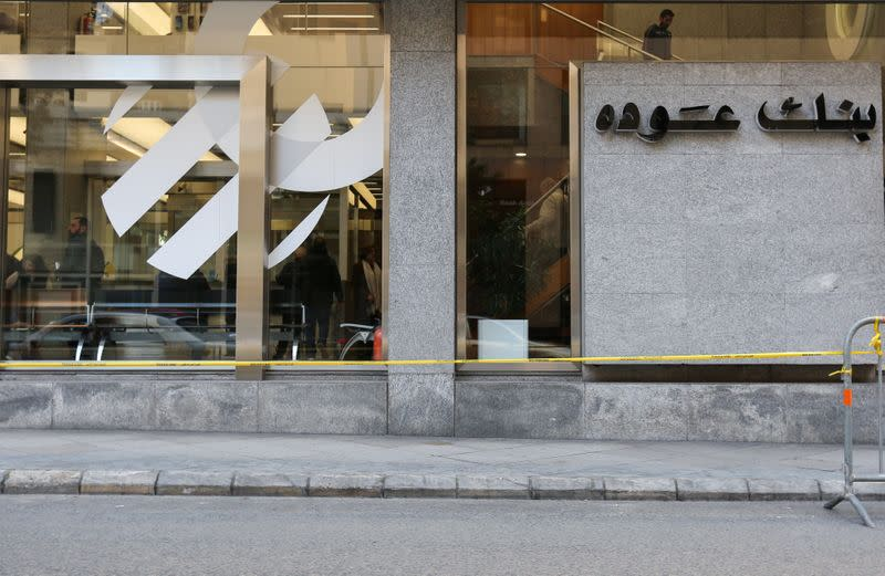 People are seen inside a branch of bank of Audi in Beirut