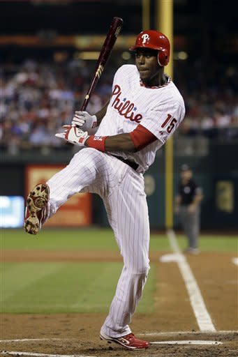 Philadelphia Phillies' John Mayberry Jr. spins out of the way of an inside pitch from Washington Nationals' Gio Gonzalez in the first inning of a baseball game, Thursday, Sept. 27, 2012, in Philadelphia. (AP Photo/Matt Slocum)