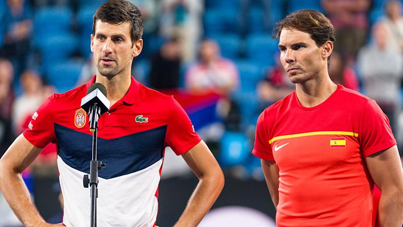 Rafael Nadal (pictured right) looking solemn and Novak Djokovic (pictured left) talking to the crowd.
