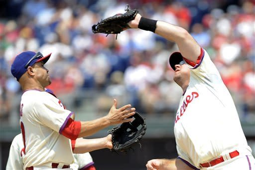 Philadelphia Phillies' Placido Polanco, left, avoids colliding with Ty Wigginton who is catching Pittsburgh Pirates' Casey McGehee pop fly in the third inning of a baseball game Thursday, June 28, 2012, in Philadelphia. (AP Photo/Michael Perez)