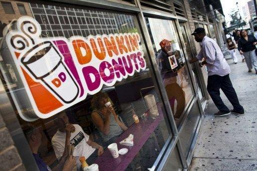 A customer enters a Dunkin' Donuts store in midtown Manhattan on July 11. Dunkin' Brands, the US fast-food chain which owns Dunkin' Donuts and Baskin-Robbins, saw its shares surge nearly 40 percent in value as they debuted on the Nasdaq stock exchange on Wednesday.