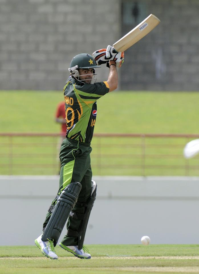 Pakistan opening batsman Ahmed Shehzad playing a cut shot during the 3rd ODI West Indies v Pakistan at Beausejour Cricket Ground, in Gros Islet, St. Lucia on July 19, 2013.  AFP PHOTO/Randy BROOKS        (Photo credit should read RANDY BROOKS/AFP/Getty Images)
