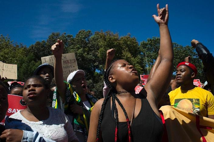Students and staff of the University of Cape Town (UCT) shout slogans during a protest against the statue of British coloniser Cecil John Rhodes at the university in Cape Town on March 20, 2015 (AFP Photo/Rodger Bosch)