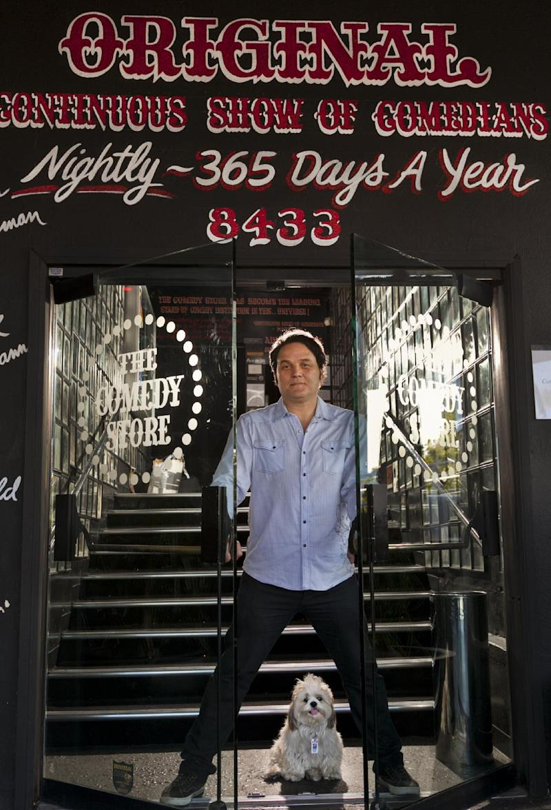 Standup comedian Jerome Cleary poses for a photo with his dog Zach, at the doors of The Comedy Store in Los Angeles on Monday, May 14, 2012. One of a legion of Facebook fans, Jerome Cleary has never wanted to own a stock as much as he wants to buy this one. The social media behemoth whose market debut is set for later this week has would-be shareholders like Cleary frothing and scrambling to get in on the initial public offering of the year.  (AP Photo/Damian Dovarganes)