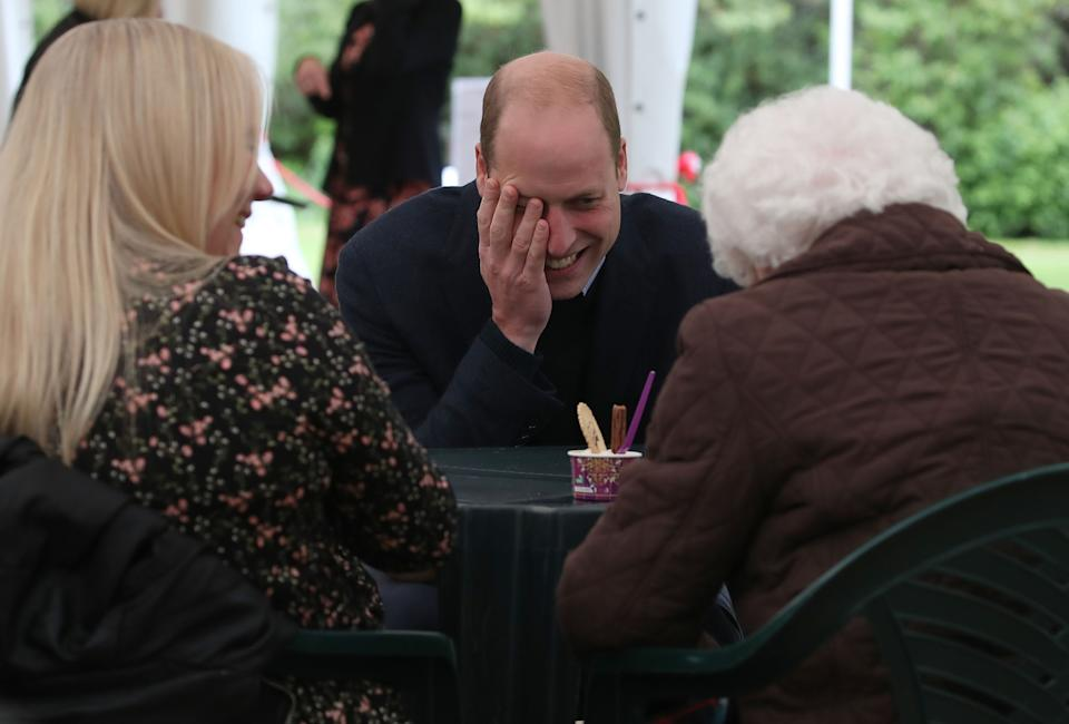 Prince William chats with Betty Magee and her granddaughter, Kimberley Anderson, during a visit to the Queens Bay Lodge Care Home on May 23 in Edinburgh, Scotland. (Photo: WPA Pool via Getty Images)