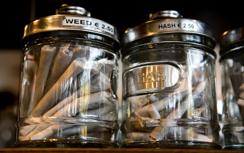 FILE PHOTO: Joints containing different types of cannabis are seen in their jars at a coffee shop in the southern Dutch city of Bergen op Zoom