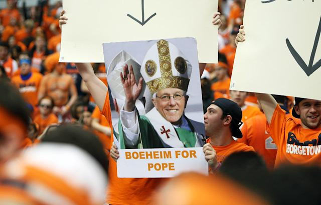 Syracuse Orange fans hold up a poster of head coach Jim Boeheim (not pictured) with the phrase 'Boeheim For Pope' during the game against the Georgetown Hoyas at the Carrier Dome on February 23, 2013 in Syracuse, New York. (Photo by Nate Shron/Getty Images)