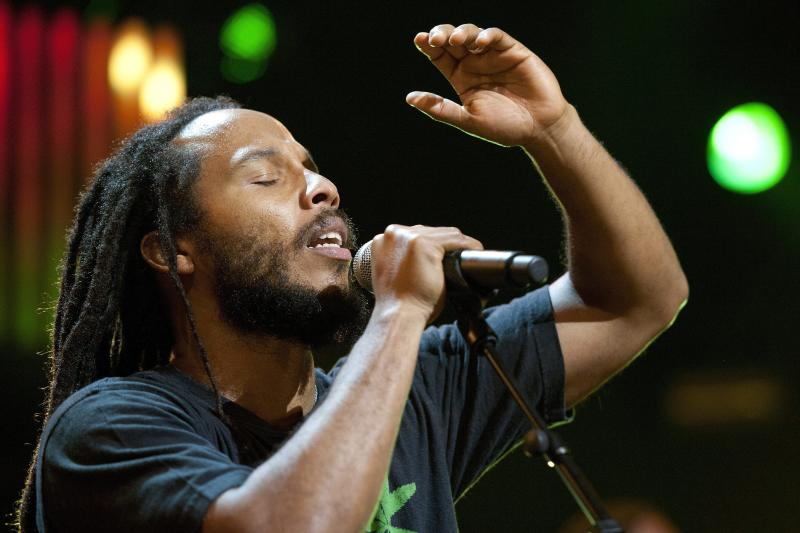 FILE - In this July 8, 2011 file photo, Jamaican singer Ziggy Marley, son of Bob Marley, performs on the Stravinski Hall stage during the 45th Montreux Jazz Festival, in Montreux, Switzerland. In a new album, the 42-year-old eldest son of Bob Marley reflects on lessons learned from his dad, who died at age 36 after contracting cancer.  (AP Photo/Keystone, Laurent Gillieron, file)   GERMANY OUT, AUSTRIA OUT