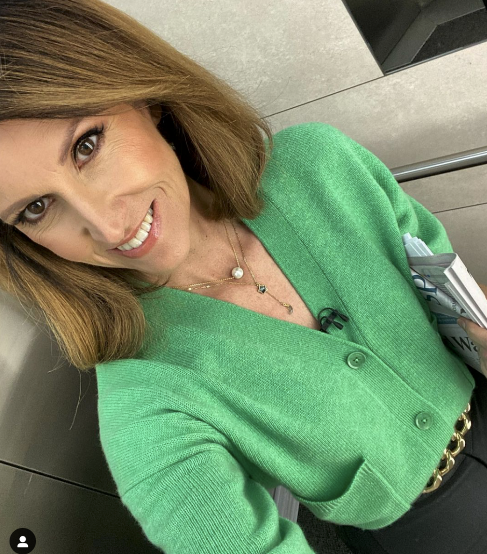 Natalie Barr in a green cardigan