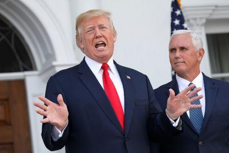 U.S. President Donald Trump speaks to reporters with Vice President Mike Pence at his side at Trump's golf estate in Bedminster, New Jersey U.S. August 10, 2017.  REUTERS/Jonathan Ernst