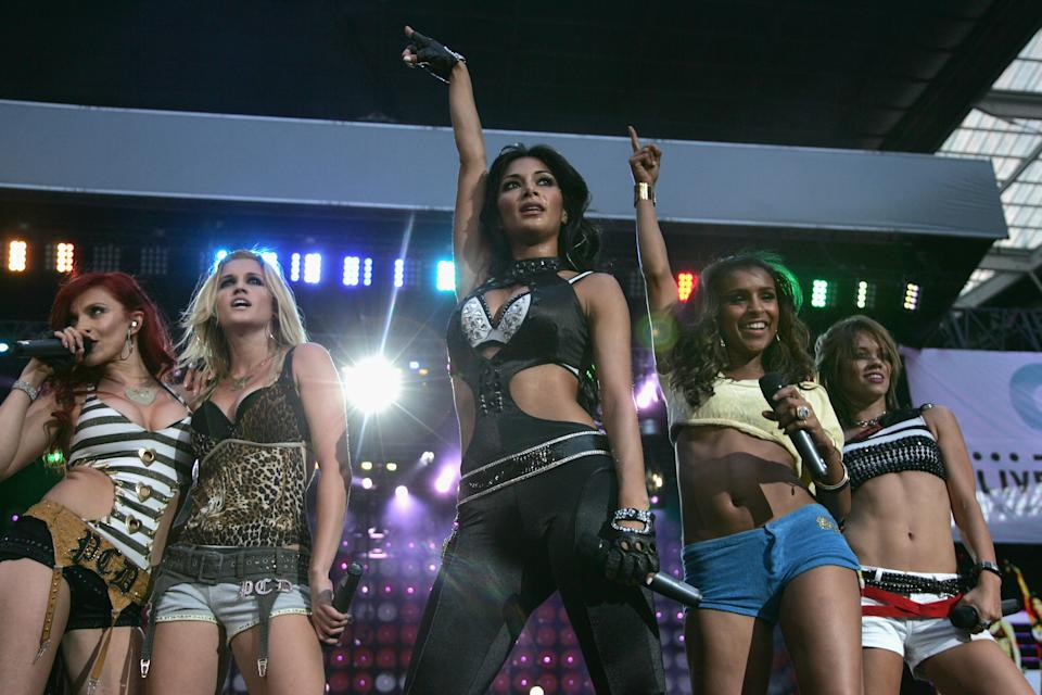 LONDON - JULY 07:  Carmit Bachar, Ashley Roberts,  Nicole Scherzinger, Melody Thornton and Kimberly Wyat of American pop group Pussycat Dolls performs on stage during the Live Earth concert held at Wembley Stadium on July 7, 2007 in London. Live Earth is a 24-hour, 7-continent concert series taking place on 7/7/07, bringing together more than 100 music artists and 2 billion people to trigger a global movement to solve the climate crisis.  (Photo by Gareth Cattermole/Getty Images)