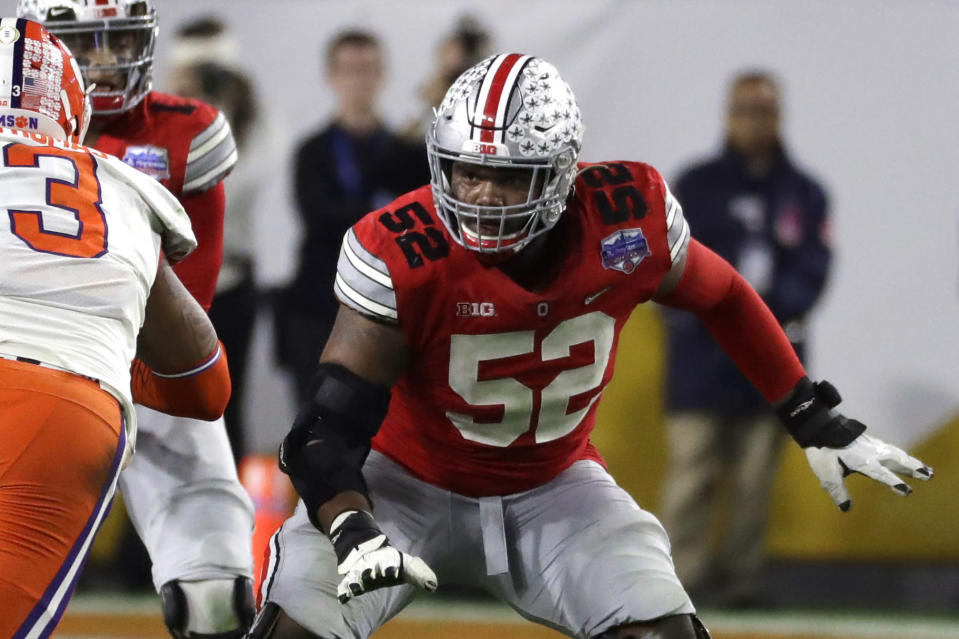 FILE - Ohio State offensive lineman Wyatt Davis (52) is shown during the first half of the Fiesta Bowl NCAA college football game against Clemson in Glendale, Ariz., in this Saturday, Dec. 28, 2019, file photo. Davis was selected to The Associated Press All-America first-team offense, Monday, Dec. 28, 2020. (AP Photo/Rick Scuteri, File)