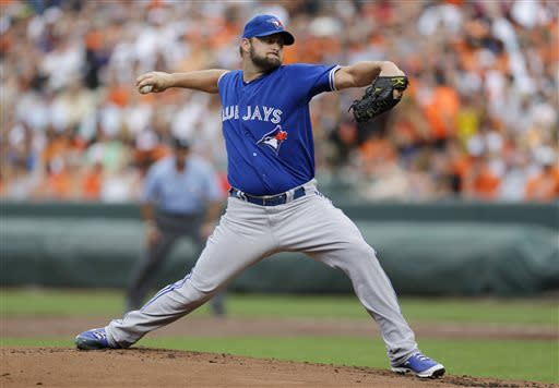 Toronto Blue Jays starting pitcher Todd Redmond throws to the Baltimore Orioles in the first inning of a baseball game, Saturday, July 13, 2013, in Baltimore. (AP Photo/Patrick Semansky)