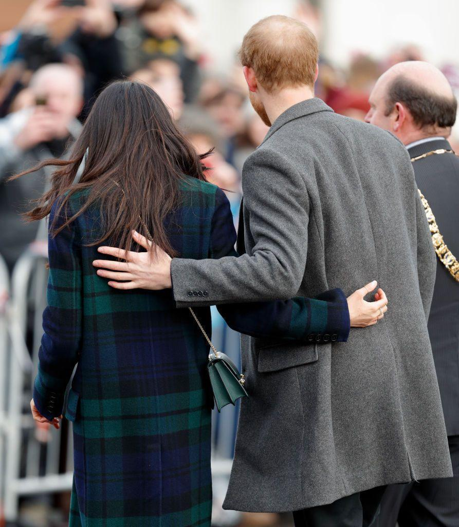<p>Hand-holding isn't the only PDA that Meghan and Harry engage in during official royal outings. Here they are with their arms around each other during a trip to Edinburgh, Scotland, in February 2018. Awwww. </p>