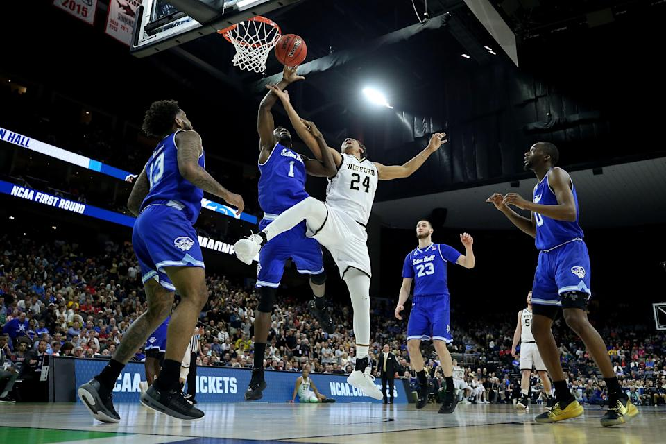 <p>Keve Aluma #24 of the Wofford Terriers attempts a shot while being guarded by Michael Nzei #1 of the Seton Hall Pirates in the first half during the first round of the 2019 NCAA Men's Basketball Tournament at Jacksonville Veterans Memorial Arena on March 21, 2019 in Jacksonville, Florida. </p>