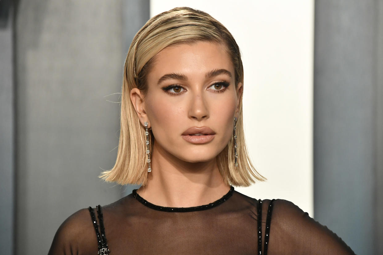 Hailey Bieber talks about experiencing body shaming while growing up in the spotlight. (Photo: Getty Images)