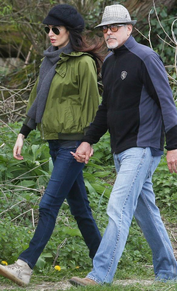 """<p>While on a romantic stroll with her actor husband, the maternity wear maven paired her olive green bomber jacket with a deep gray scarf, dark-wash skinny jeans, and studded high-top sneakers (shop a similar look <a rel=""""nofollow"""" href=""""https://click.linksynergy.com/fs-bin/click?id=93xLBvPhAeE&subid=0&offerid=255436.1&type=10&tmpid=10034&RD_PARM1=https%253A%252F%252Fwww.farfetch.com%252Fshopping%252Fwomen%252Fleather-crown-studded-hi-top-sneakers-item-11940084.aspx%253F&u1=ISAmalMaternityIJApril"""">here</a>). She added a touch of black to the ensemble with a newsboy cap and aviator shades. </p><p> </p>"""