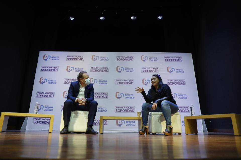 """Olimpia Coral Melo, right, who became an activist against online sexual harassment and assault after a video of her having sex was published online in 2013, speaks with Benito Juarez borough Mayor Santiago Taboada, during a live broadcast in Mexico City, Monday, Nov. 23, 2020. Melo's story and subsequent activism have led to the creation of numerous state laws against cyber violence, and Mexico's government is on the verge of passing a federal version of """"Olimpia's Law."""" (AP Photo/Rebecca Blackwell)"""