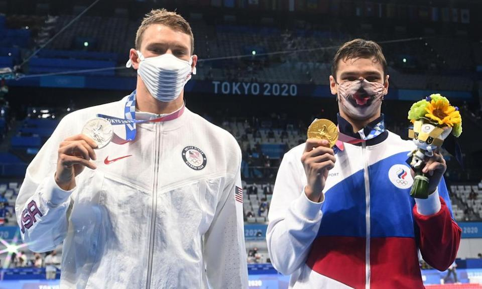 Ryan Murphy (left), silver medallist in the men's 200m backstroke gold medallist, said after the ROC's Evgeny Rylov (right) took gold: 'I'm swimming in a race that's probably not clean.'