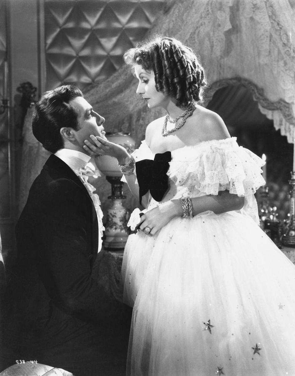 <p>Greta Garbo was one of Hollywood's most enigmatic stars, but one thing about her that <em>wasn't</em> a mystery? Her jewelry in <em>Camille</em> was beyond enviable. For the film, Garbo paired an off-the-shoulder, tulle ballgown with a golden woven necklace and bracelet set that was both chic and classic. </p>