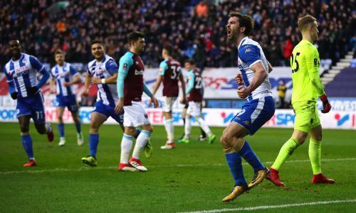 Will Grigg hits double as Wigan cause FA Cup upset against 10-man West Ham