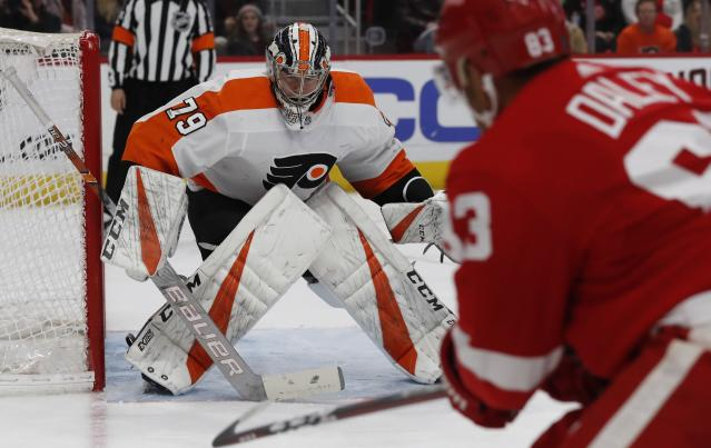 Detroit Red Wings defenseman Trevor Daley (83) shoots towards Philadelphia Flyers goaltender Carter Hart (79) during the second period of an NHL hockey game, Sunday, Feb. 17, 2019, in Detroit. (AP Photo/Carlos Osorio)