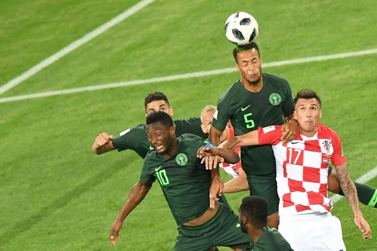 Nigeria's defender William Troost-Ekong heads the ball over Croatia's forward Mario Mandzukic during the Russia 2018 World Cup Group D football match at the Kaliningrad Stadium in Kaliningrad on June 16, 2018