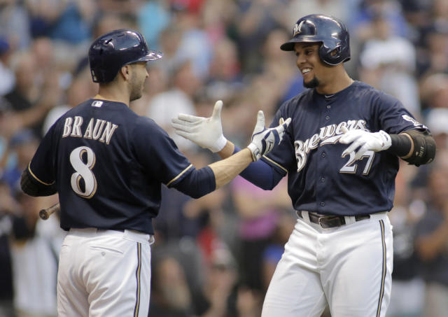 Milwaukee Brewers' Carlos Gomez, right, celebrates his home run against the Los Angeles Dodgers with Ryan Braun, left, during the sixth inning of a baseball game Saturday, Aug. 9, 2014, in Milwaukee. (AP Photo/Darren Hauck)