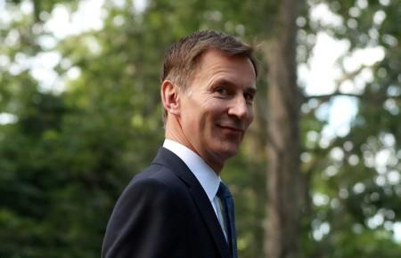 FILE PHOTO: Conservative Party leadership candidate Jeremy Hunt leaves his home in London